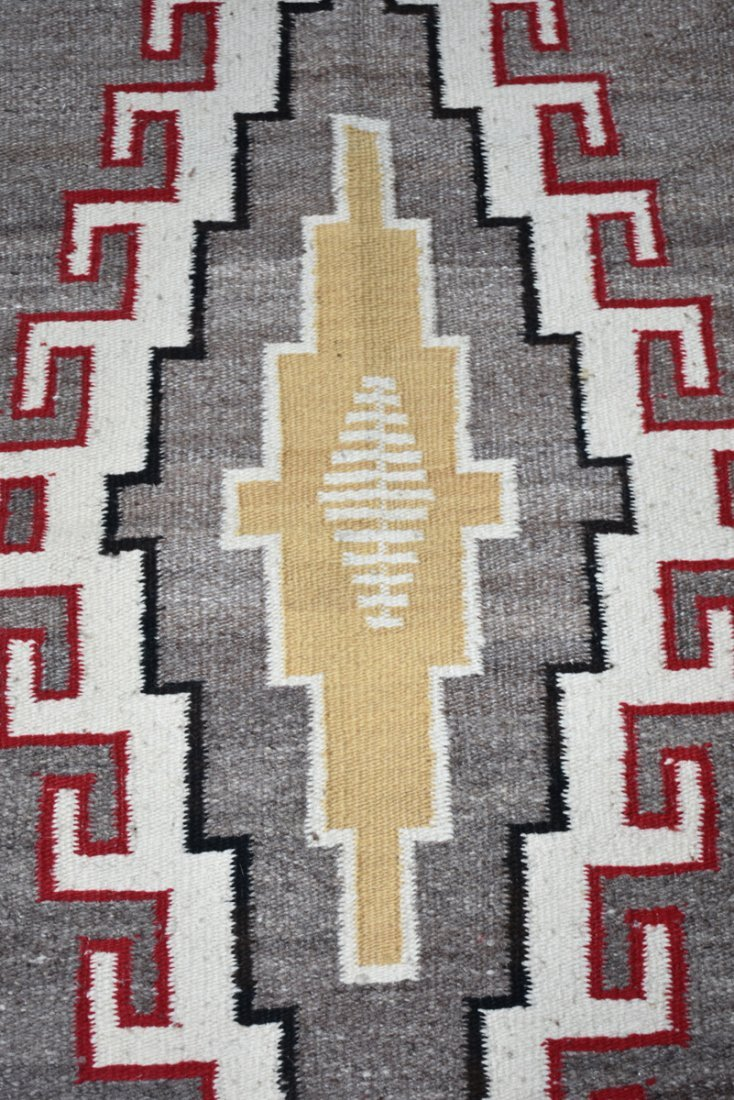 A NATIVE AMERICAN POLYCHROME WOVEN WOOL RUG, 20TH - 5