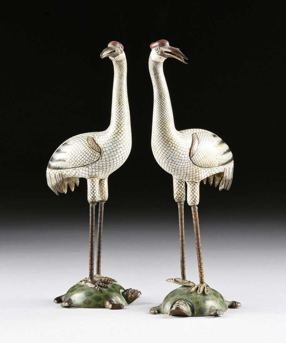 A PAIR OF CHINESE POLYCHROME ENAMELED CLOISONNÉ CRANES,