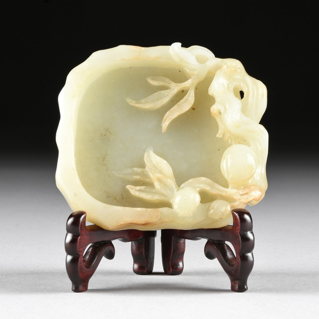 AN ANTIQUE CHINESE CARVED PALE CELADON JADE BRUSH