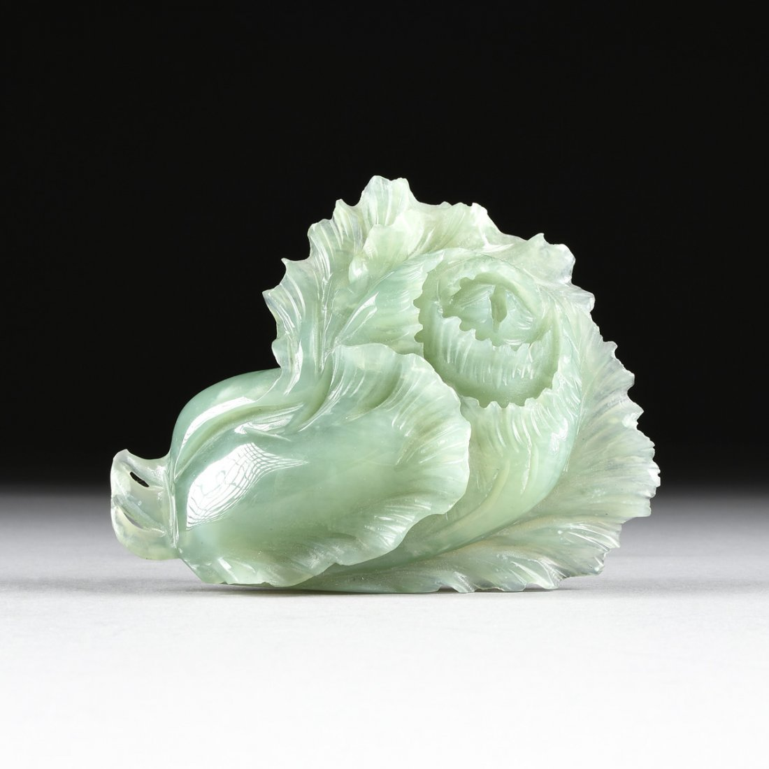 A CHINESE CARVED CELADON JADE OF A BLOSSOM, MODERN,