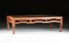 A CHINESE GLASS TOPPED CARVED WOOD COFFEE TABLE,
