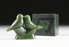 AN INUIT CARVED SPINACH JADE GROUP OF LOVE BIRDS