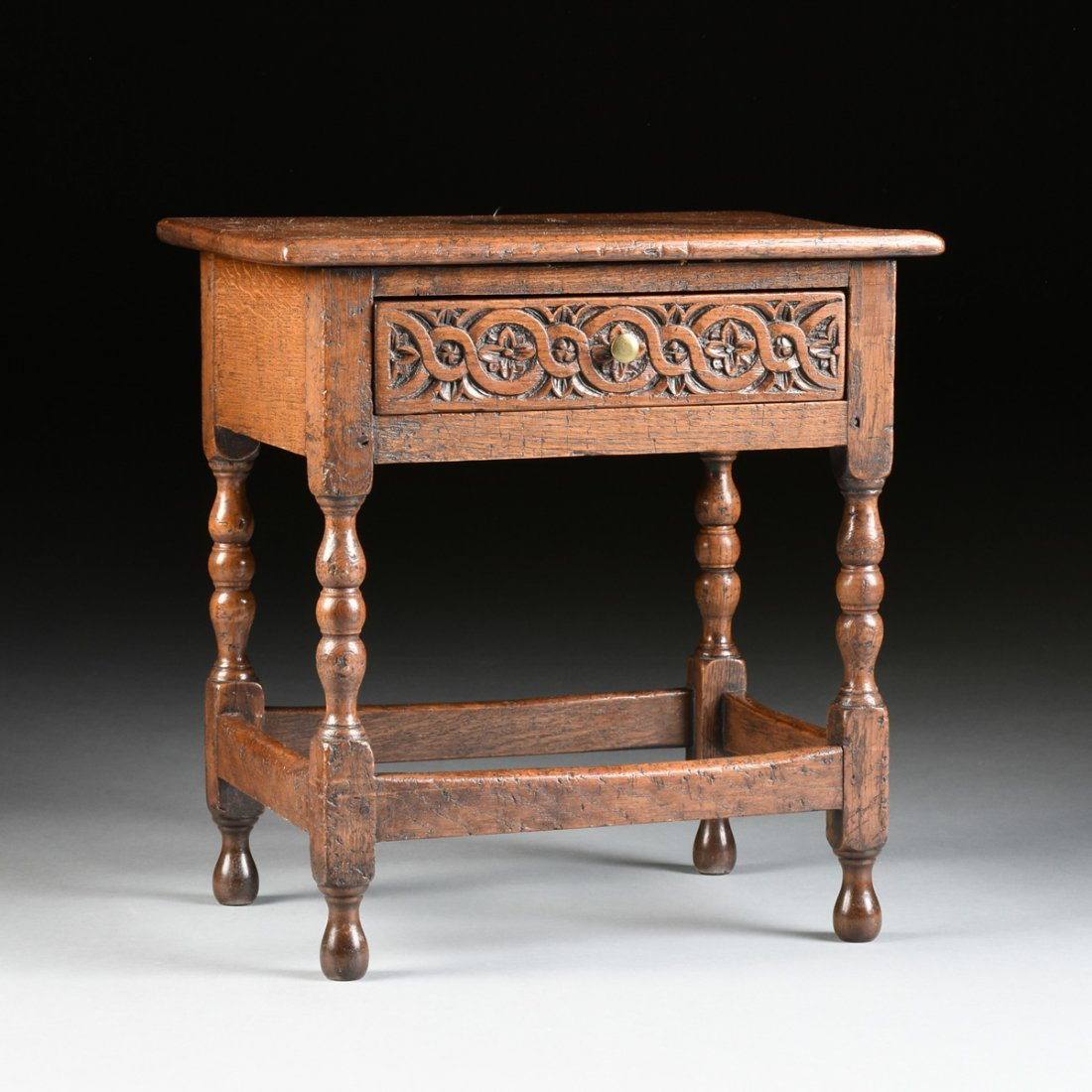 A WILLIAM AND MARY STYLE CARVED OAK SIDE TABLE,