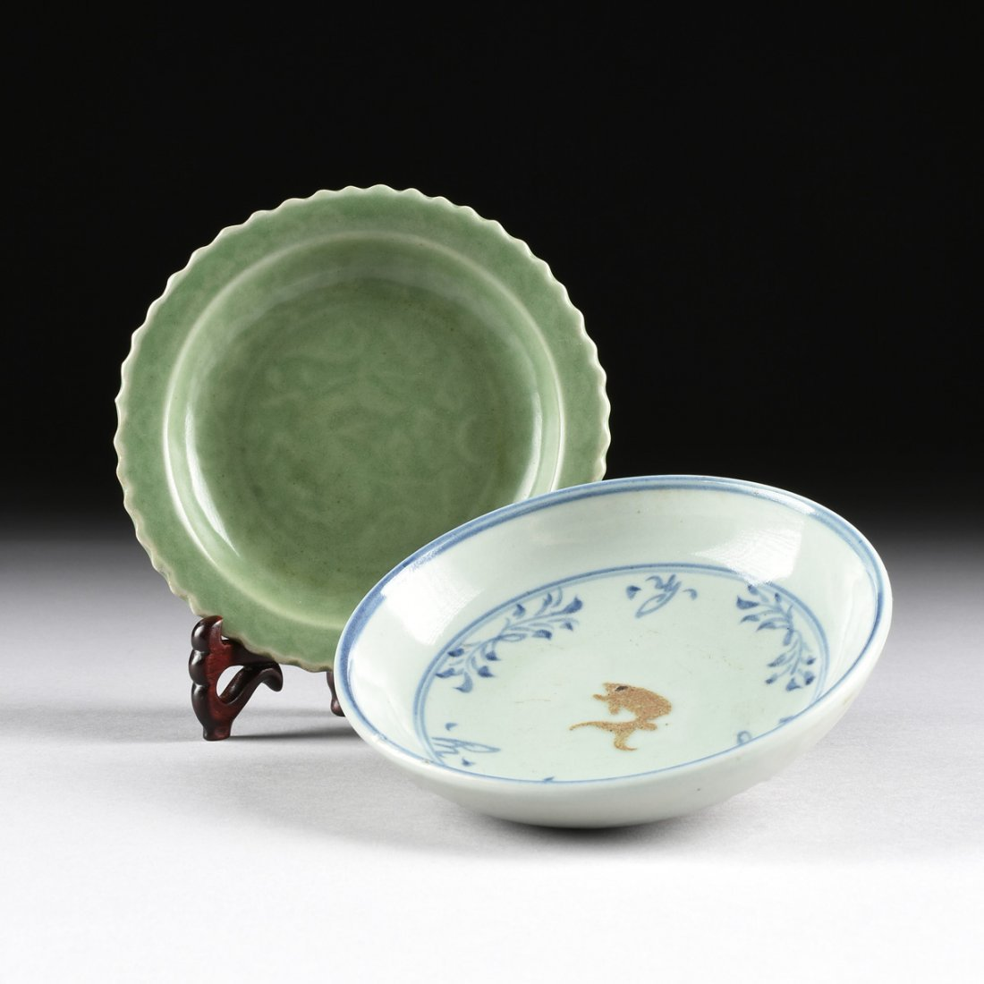 A CHINESE SMALL BARB RIMMED CELADON DISH, TOGETHER WITH
