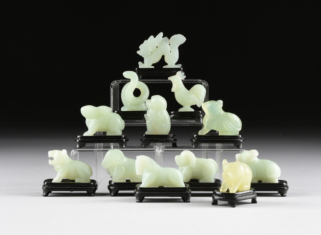 A SET OF TWELVE CHINESE CELADON JADE ZODIAC ANIMAL