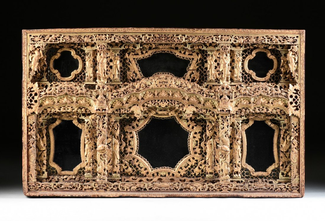 AN UNUSUAL CHINESE ORNATELY CARVED GILTWOOD MIRROR,