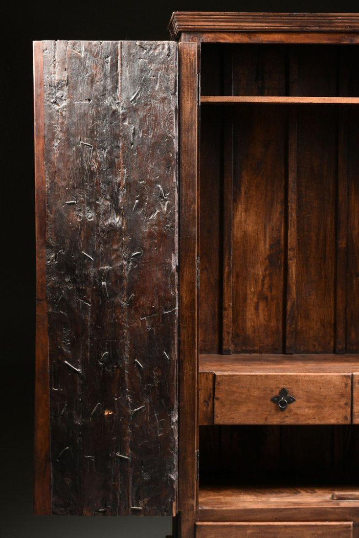 A SPANISH COLONIAL STYLE CARVED WOOD ARMOIRE, 19TH - 10