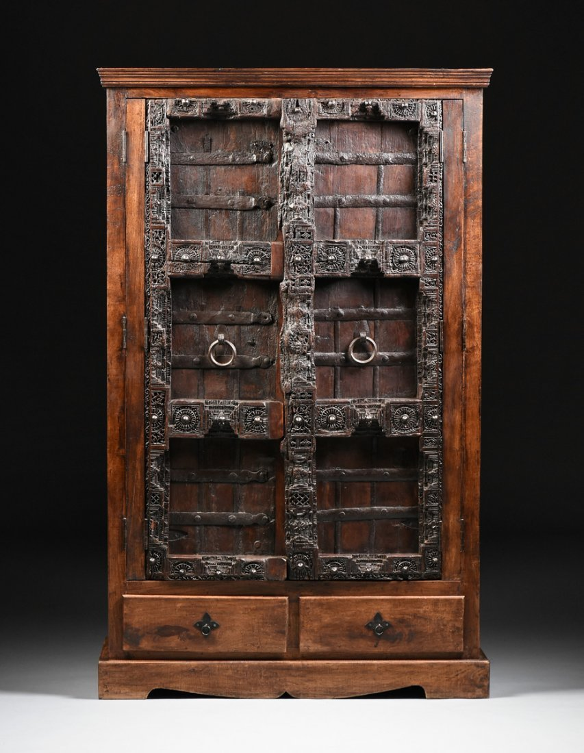 A SPANISH COLONIAL STYLE CARVED WOOD ARMOIRE, 19TH