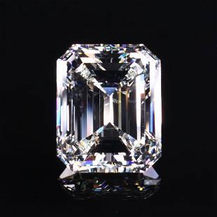 A YELLOW GOLD AND 14.73 CT J VS1 EMERALD CUT DIAMOND