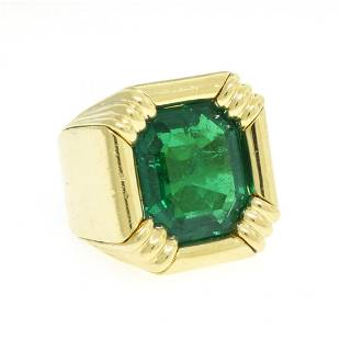 AN 18K YELLOW GOLD AND EMERALD HENRY DUNAY LADY'S RING,