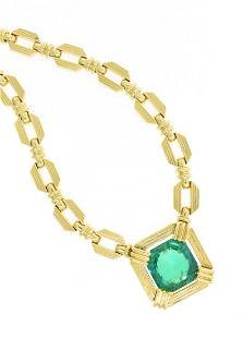 AN 18K YELLOW GOLD AND EMERALD HENRY DUNAY LADY'S