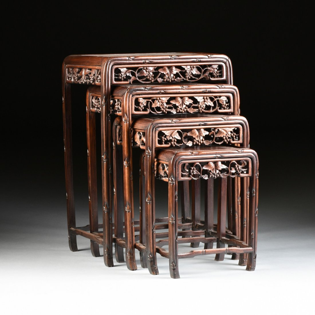 """A SET OF FOUR CHINESE CARVED HARDWOOD """"GRAPEVINE AND"""
