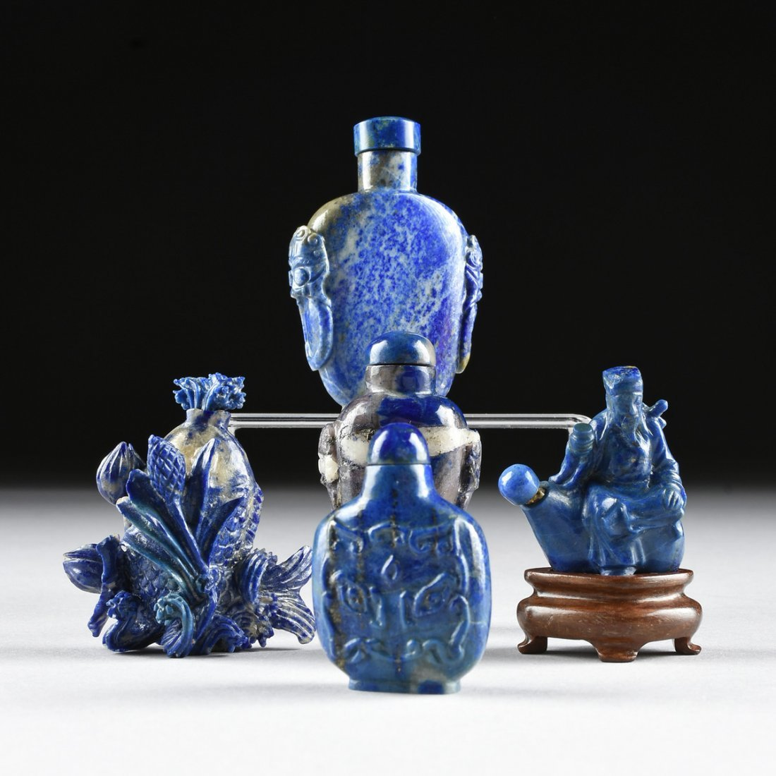 A GROUP OF FIVE CHINESE CARVED LAPIS SNUFF BOTTLES,