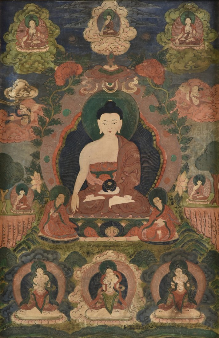 A TIBETAN POLYCHROME PAINTED AND FRAMED THANGKA,