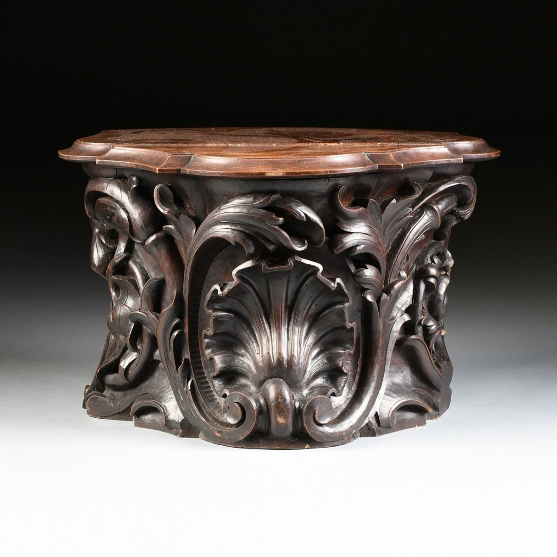 A ROCOCO REVIVAL STYLE CARVED WALNUT PEDESTAL BASE