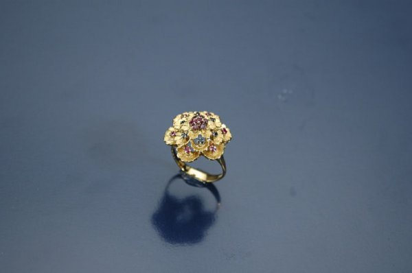 6: AN ITALIAN 18K YELLOW GOLD,  sapphire and ruby lady'