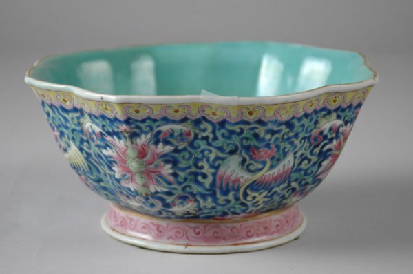 8: A CHINESE FAMILLE ROSE BOWL enameled with flowers al