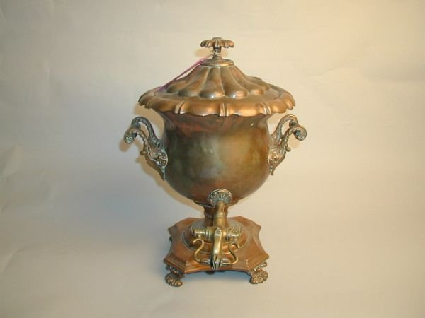 10: AN ANTIQUE ENGLISH COPPER AND BRASS, samovar on paw