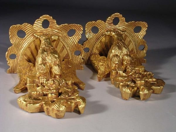 16: A PAIR OF CARVED AND GILTWOOD wall brackets, each p
