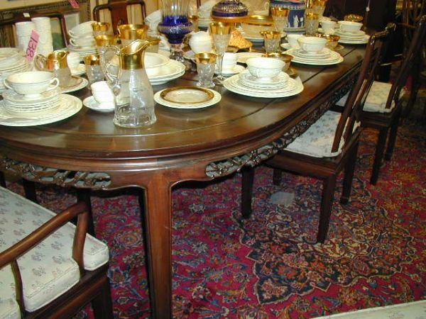 17: A CHINESE STYLE MAHOGANY dining table, the oval top