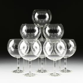 A SET OF EIGHT LARGE CLEAR CRYSTAL FISH BOWL STEM