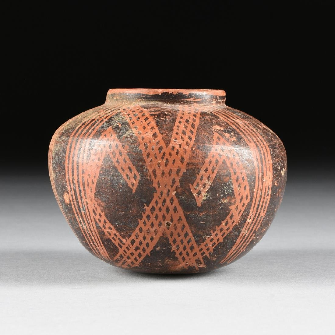 A PRE-COLUMBIAN STYLE SLIP DECORATED TERRACOTTA VASE,