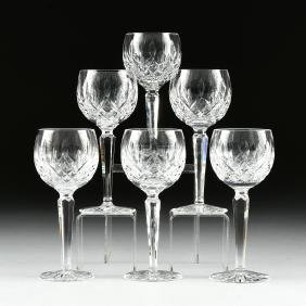 A SET OF SIX WATERFORD CUT CRYSTAL BALLOON WINE GLASSES