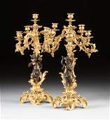 A PAIR OF FRENCH LOUIS XV STYLE GILT AND PATINATED