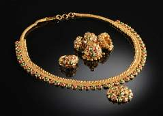AN 18K YELLOW GOLD LADY'S NECKLACE, EARRINGS, AND RING
