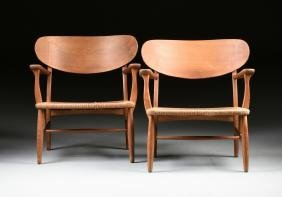 "HANS WEGNER (Danish 1914-2007) A PAIR OF ""CH22"" OAK AND"