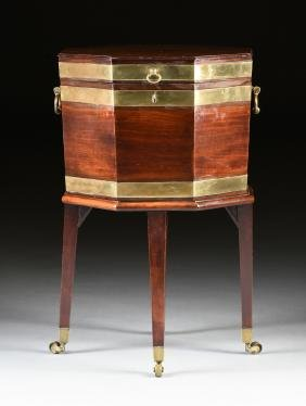 AN ENGLISH BRASS BANDED MAHOGANY CELLERETTE ON STAND,