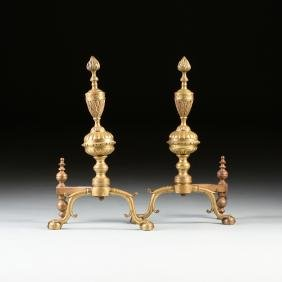 A PAIR OF ENGLISH REGENCY GILT BRASS AND IRON ANDIRONS,