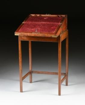 A CAMPAIGN BRASS MOUNTED MAHOGANY LAPTOP WRITING BOX ON