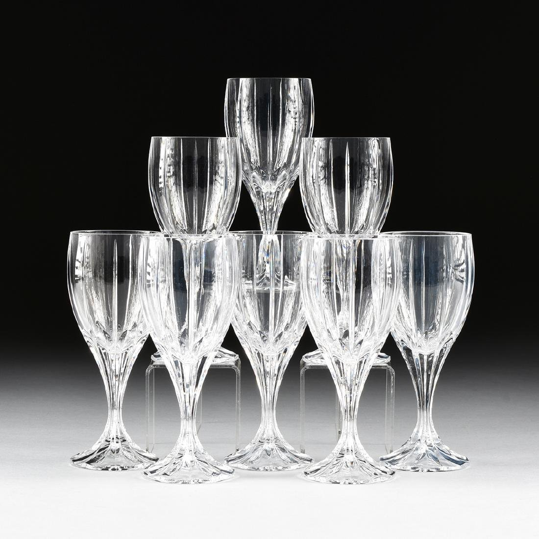 A SET OF EIGHT CRYSTAL CLEAR INDUSTRIES CUT CRYSTAL