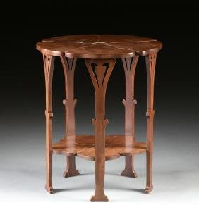 AN ART NOUVEAU STYLE CARVED MAHOGANY SIDE TABLE, EARLY