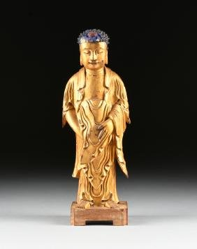 A CHINESE GILTWOOD CARVED BUDDHA ON STAND, MING STYLE,