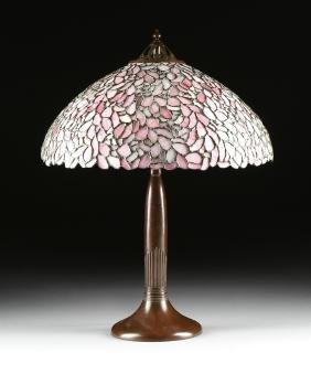 A HANDEL LAMP CO. CAST BRONZE THREE-LIGHT TABLE LAMP