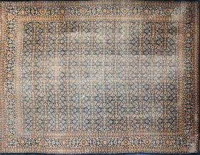 A LARGE ANTIQUE HAND WOVEN PERSIAN WOOL AND COTTON