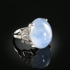 A PLATINUM AND STAR SAPPHIRE AND DIAMOND LADY'S RING,