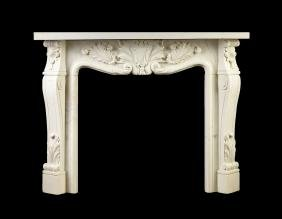 A NEOCLASSICAL STYLE CARVED WHITE MARBLE FIREPLACE,