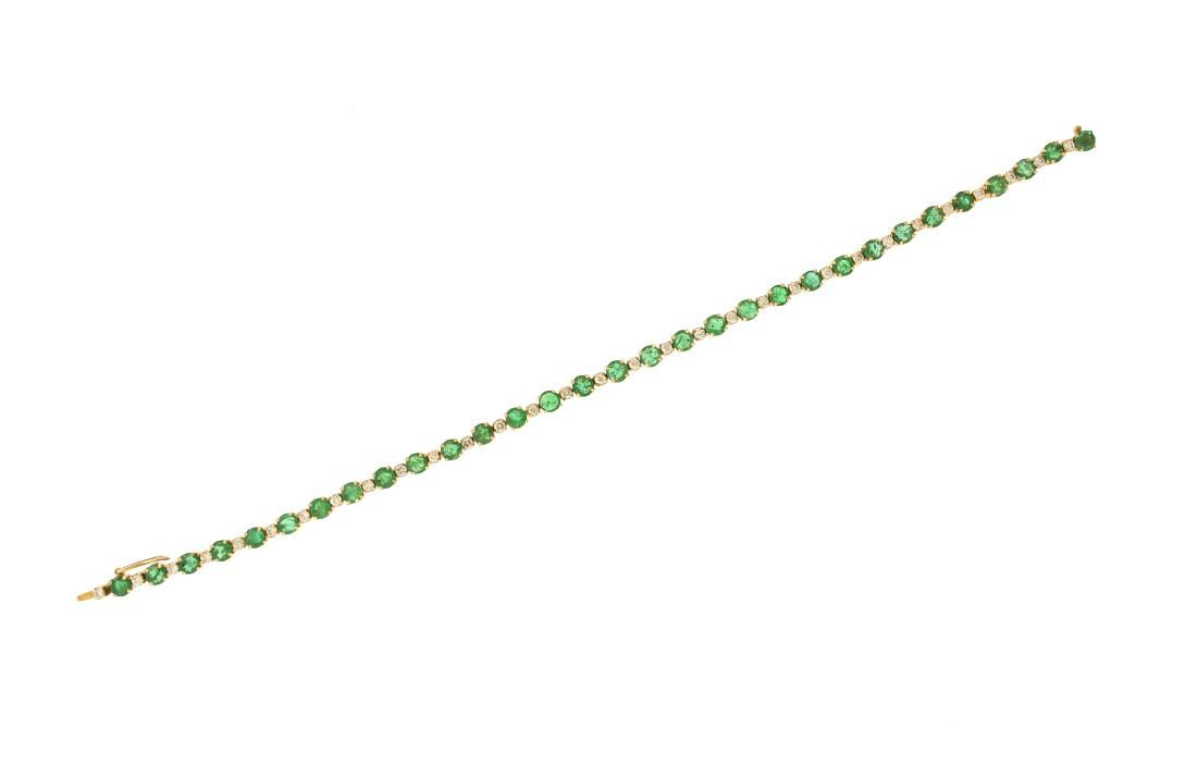 AN 18K YELLOW GOLD, EMERALD AND DIAMOND LADY'S