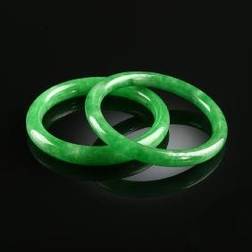 A GROUP OF TWO CHINESE JADEITE JADE BANGLES, MODERN,