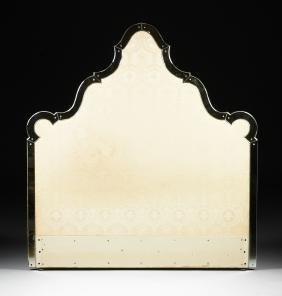A HOLLYWOOD REGENCY STYLE MIRRORED AND UPHOLSTERED