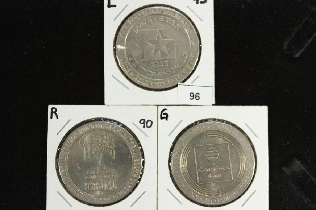 3 ASSORTED SOUTH DAKOTA $1 GAMING TOKENS
