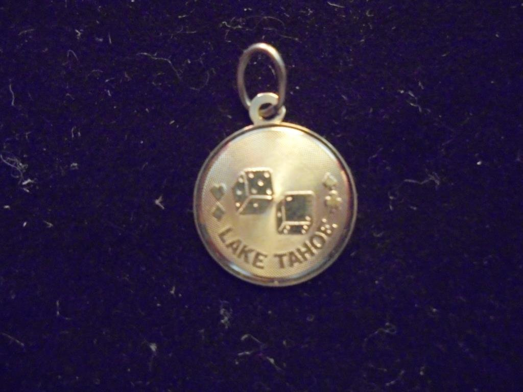 14KT GOLD LAKE TAHOE CHARM APPROX. .7 GRAMS GOLD