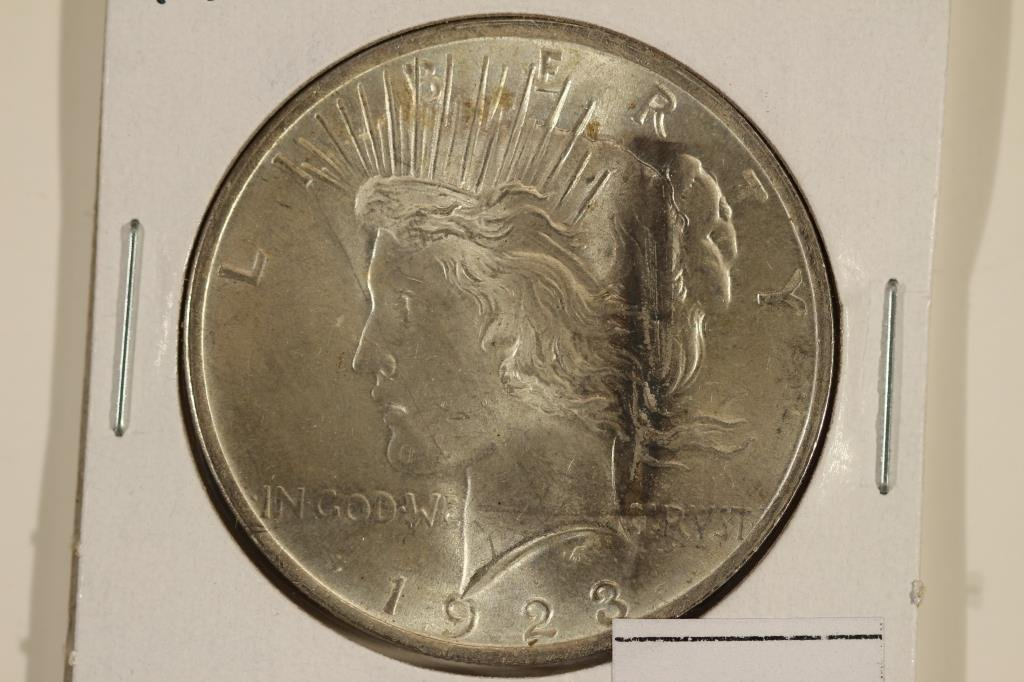 1923 PEACE SILVER DOLLAR UNC WITH TONING