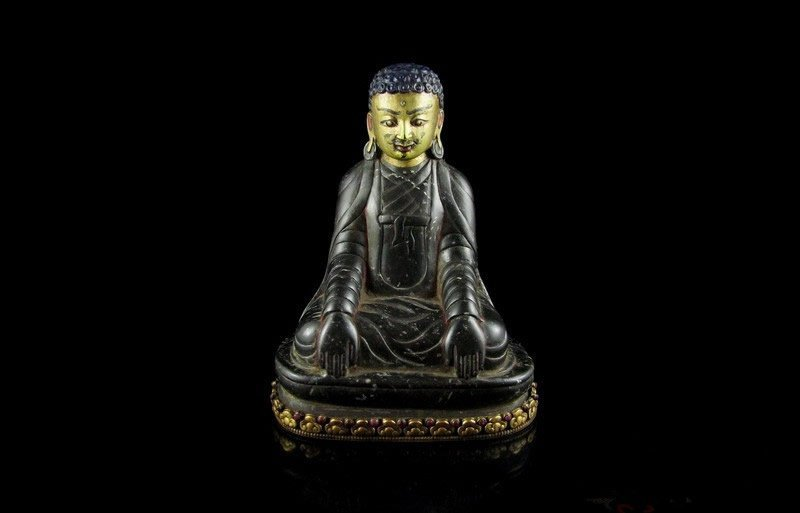 Black stone carving of Buddha