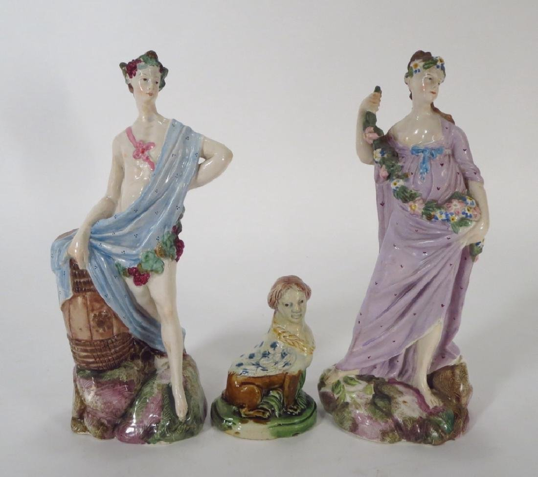 Three Staffordshire Figures, one a Sphinx, 19th c.