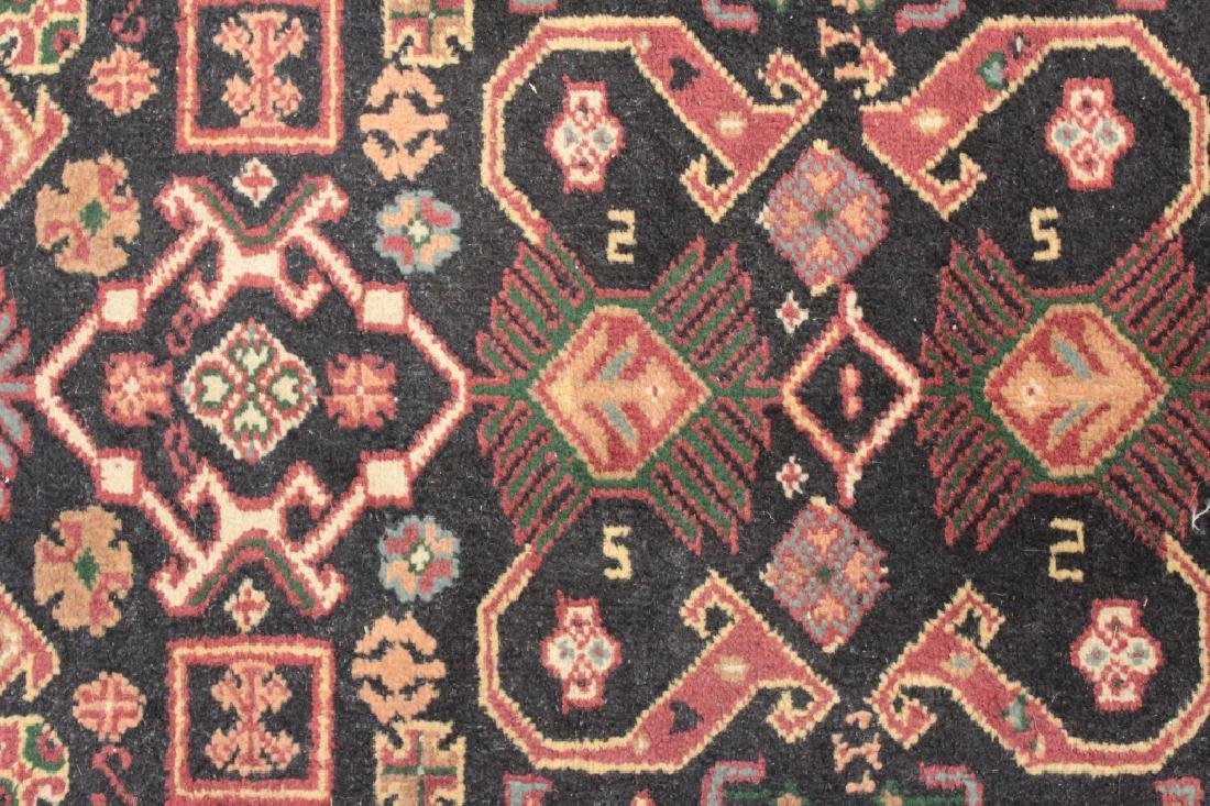 Two Oriental Rugs - Black & Red Grounds