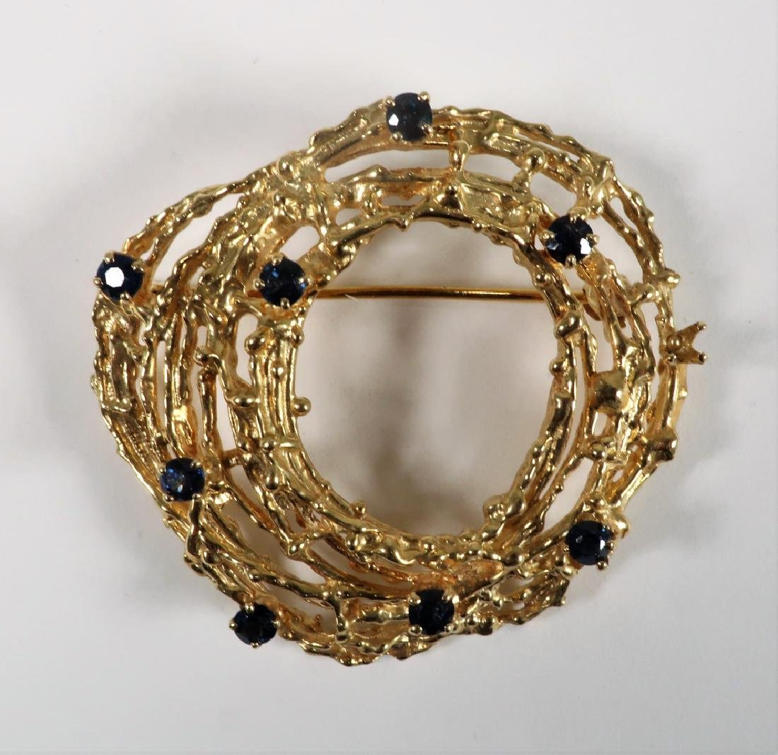 18 K Gold Brooch with Nine Sapphires 17.7 Grams